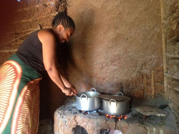 Congolese refugee Masika tends to a bubbling stew in her restaurant in Ethiopia's Sherkole camp. © UNHCR Photo Uni