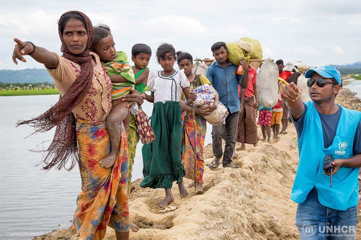 Rohingya refugees make their way to a camp