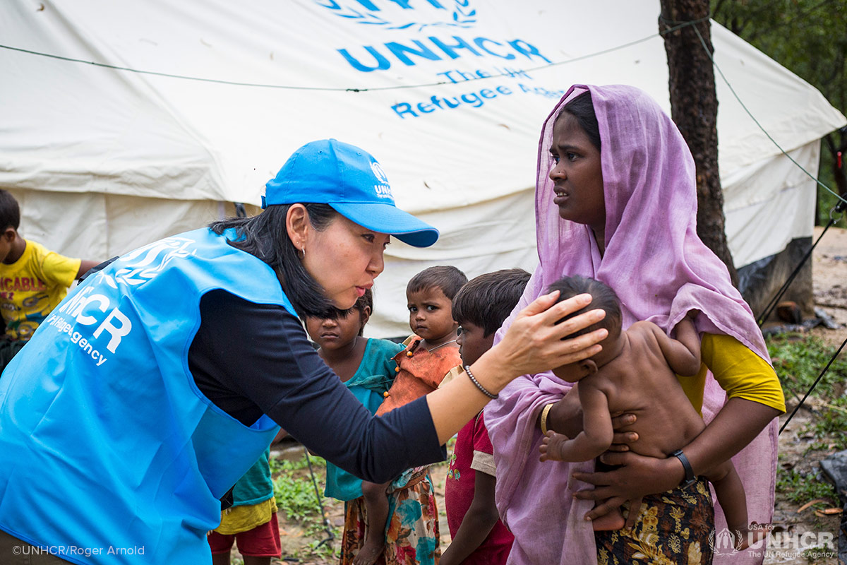 Joung-ah talks to a baby at a Rohingya refugee camp