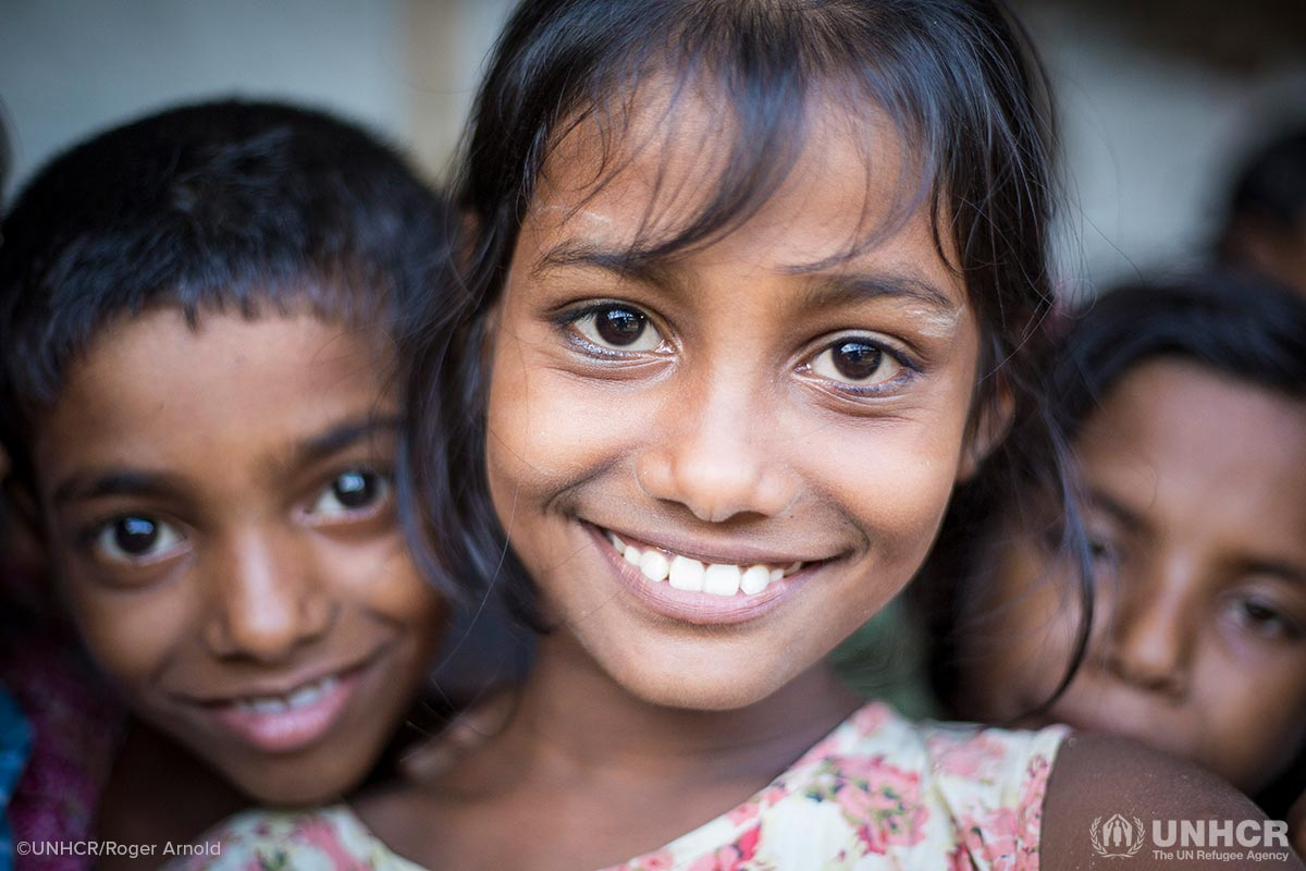Smiling children in a Rohingya refugee camp