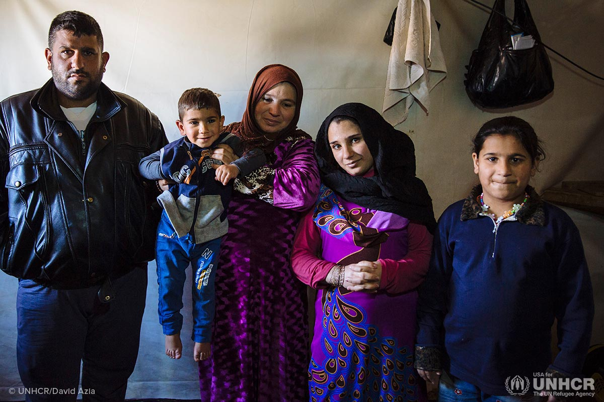 From left, Syrian refugees Khaled, 35, Yehya, 3, Najaf, 41, Nadia, 12, and Nawfa, 11, pose for a photograph in their shelter at an informal settlement near Terbol in the Bekaa Valley