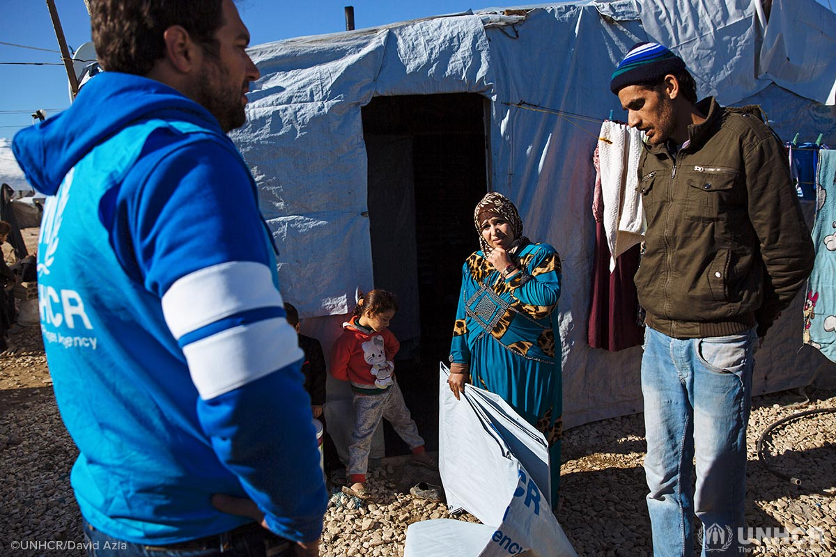 Syrian refugees Hamra and Malek receive winter assistance from UNHCR for their shelter in Lebanon.