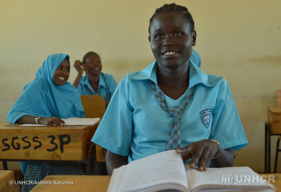 18-year-old South Sudan refugee Esther Nyakong sits in a classroom in Kenya.