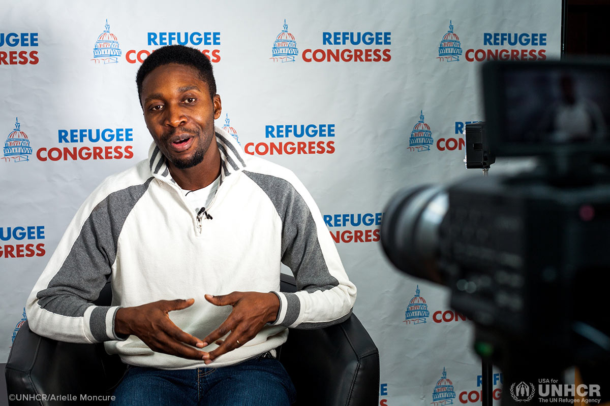 Refugee advocate, Fidel Nshombo, practices on-camera interviews.