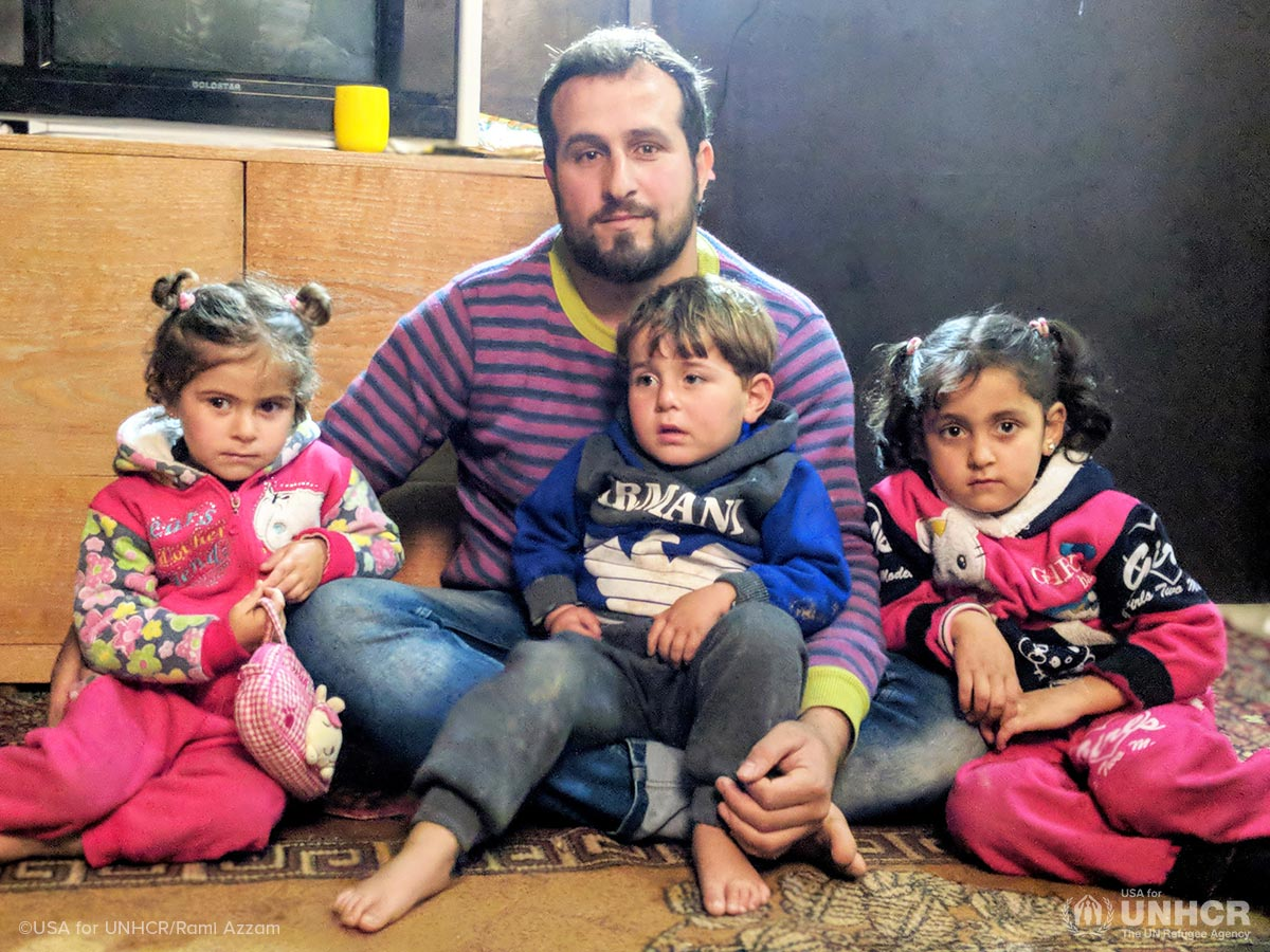 A Syrian refugee family gathers in their home at an informal settlement in Lebanon.