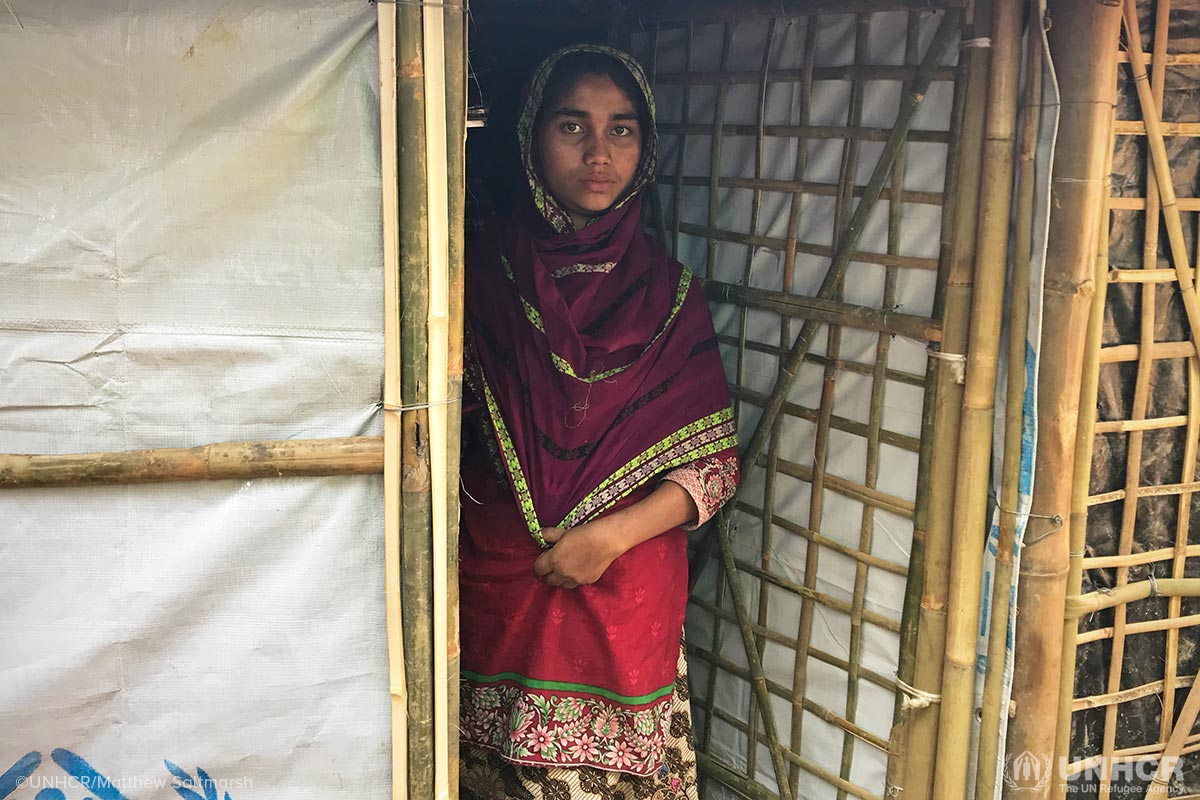 Sahar, 18, saw her mother, father and brother burned alive before she escaped her village in Myanmar. She lives alone in the densely crowded Kutupalong refugee camp, spending her nights in her bamboo-tarpaulin shelter, fearful of venturing out. During the day, she has companionship from her neighbour, with whom she shares menial tasks.