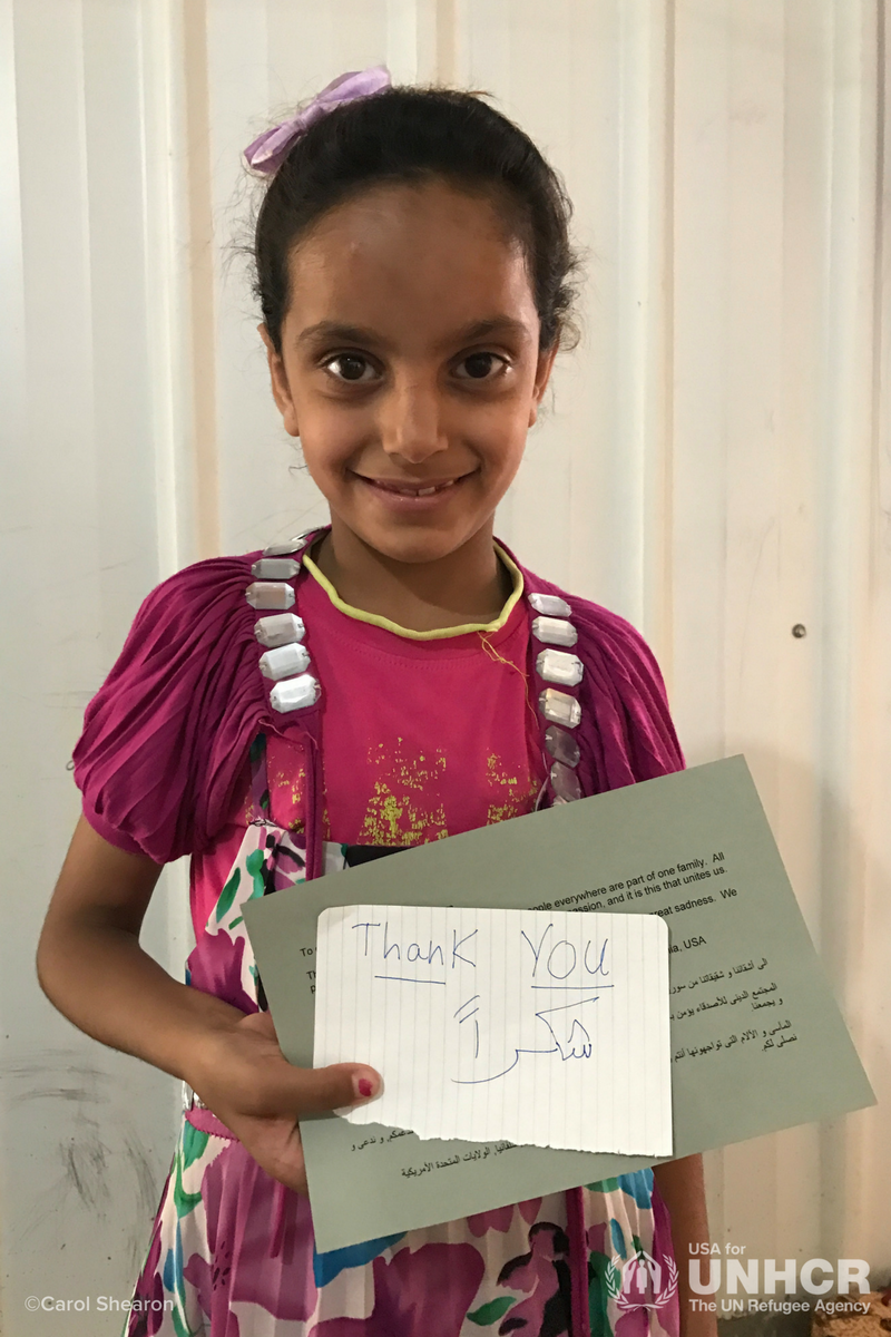 Girl with thank you note from Carol Shearon's mission trip to Jordan
