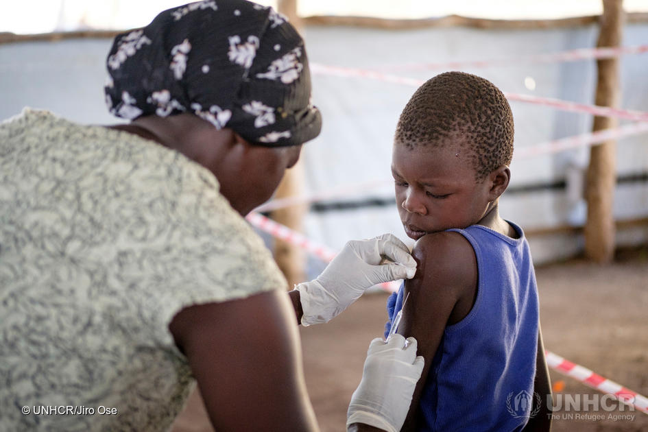 A child receive vaccination upon arrival at Imvepi reception center in Northern Uganda