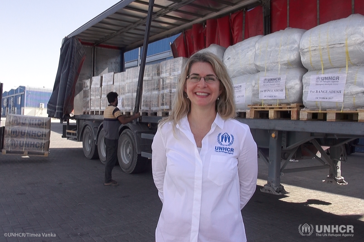 UNHCR's Head of Supply Management and Logistics Anna Spindler in front of a truck being loaded with core relief items from UNHCR's warehouse in Dubai, in preparation for an airlift to Bangladesh.