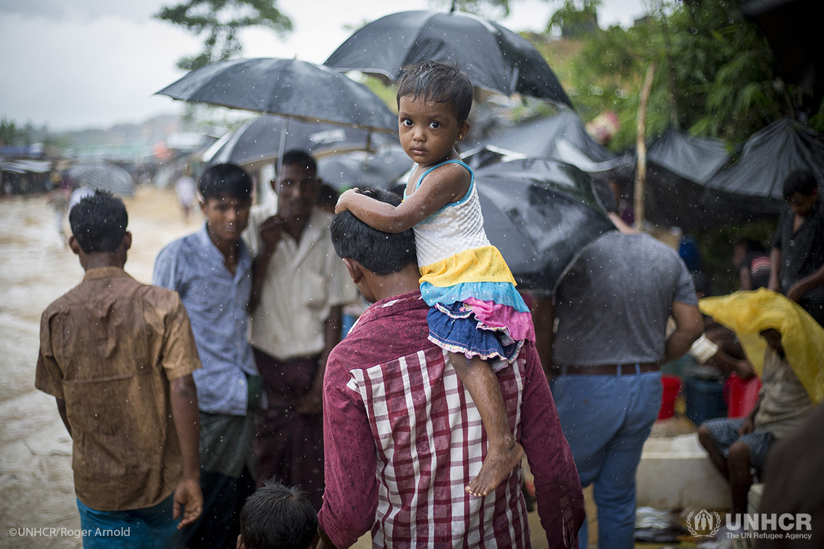 Rohingya refugees make their way down a footpath during a heavy monsoon downpour in Kutupalong refugee settlement.