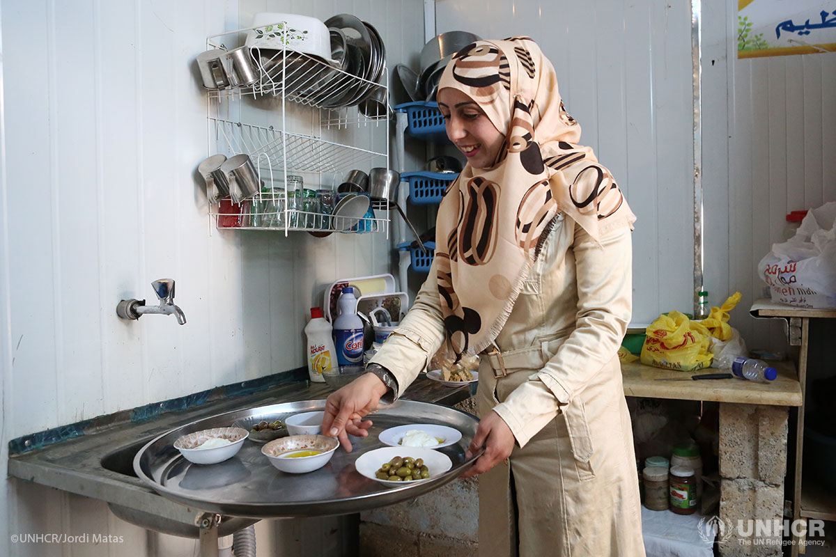 Syrian refugee Um Murad works behind-the-scenes in her wedding shop in Za'atari refugee camp.