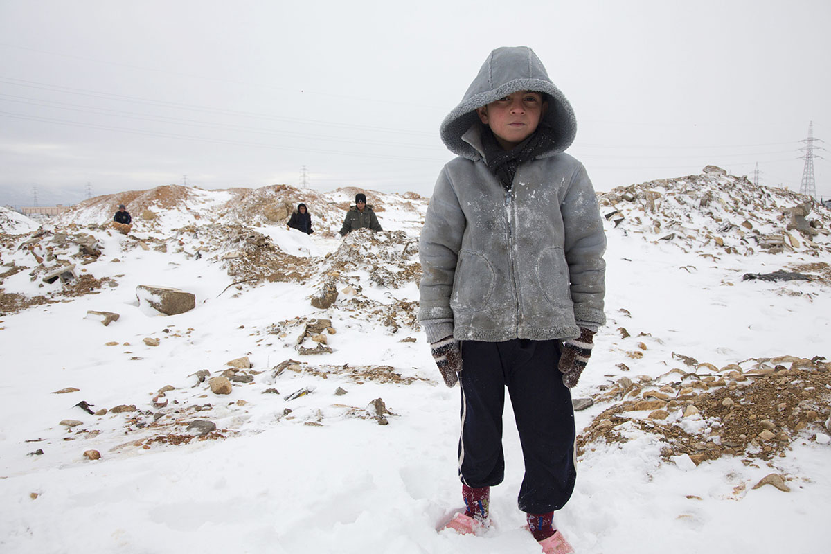 Nyeman braves a snowy December day in Lebanon's Bekaa Valley, home to hundreds of thousands of Syrian refugees.