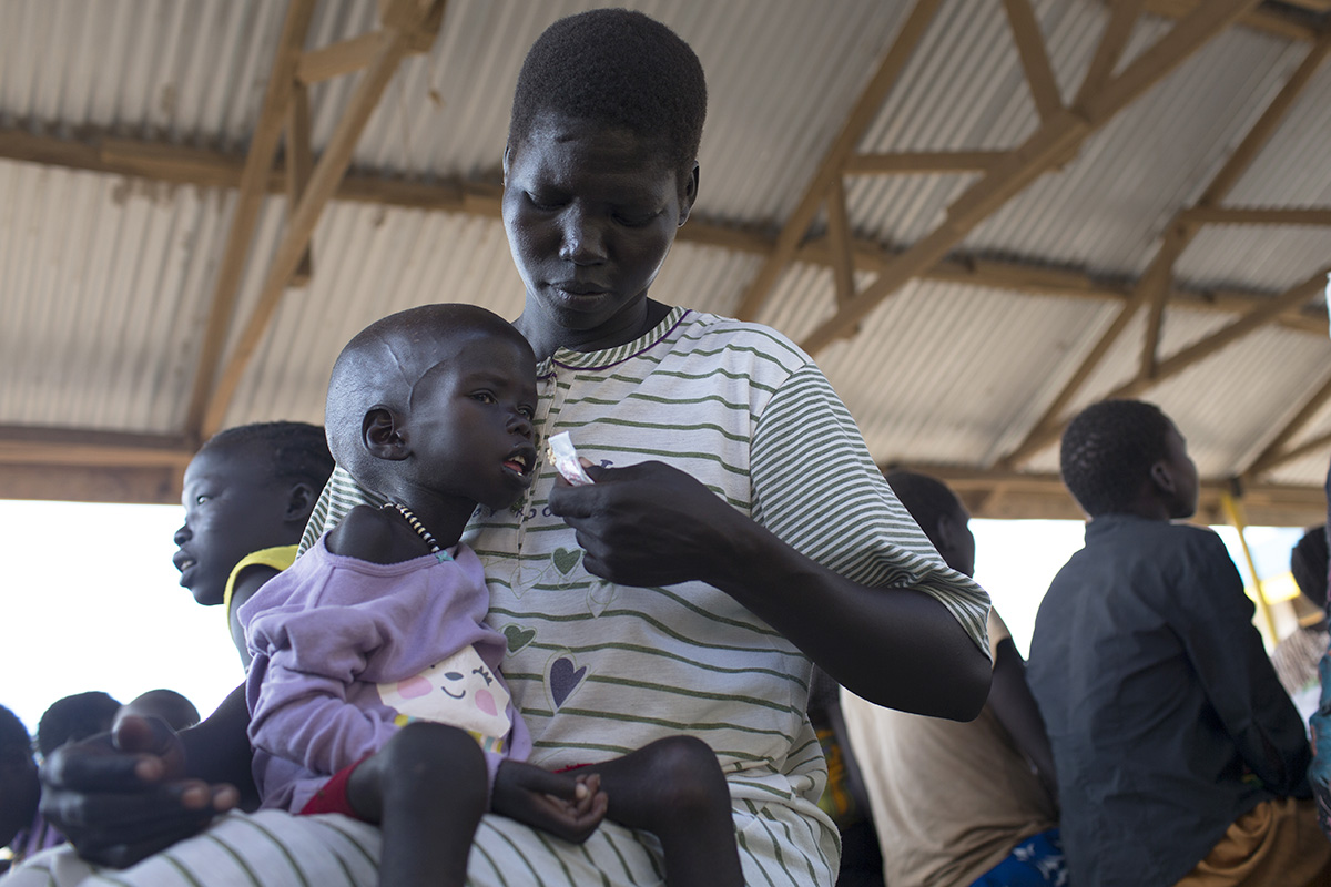 "A refugee from South Sudan, Rose feeds therapeutic foods to her son at a UNHCR-supported outpatient clinic in Kenya's Kakuma refugee camp. ""When he was admitted, he almost died. Before he was not able to open his mouth to drink or eat properly,"" says Rose."