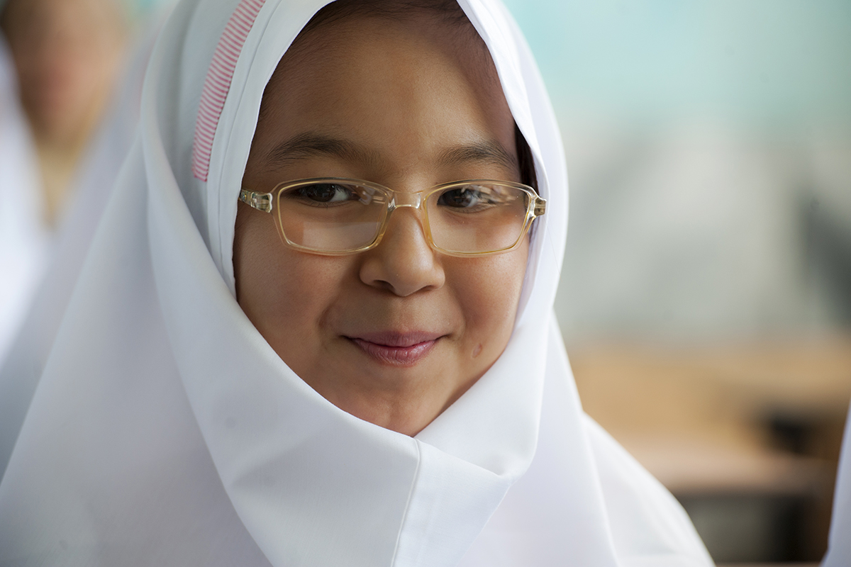 Thanks in part to her eyeglasses, 11-year-old Nargess, a refugee girl from Afghanistan, is a top student at her school in Iran.