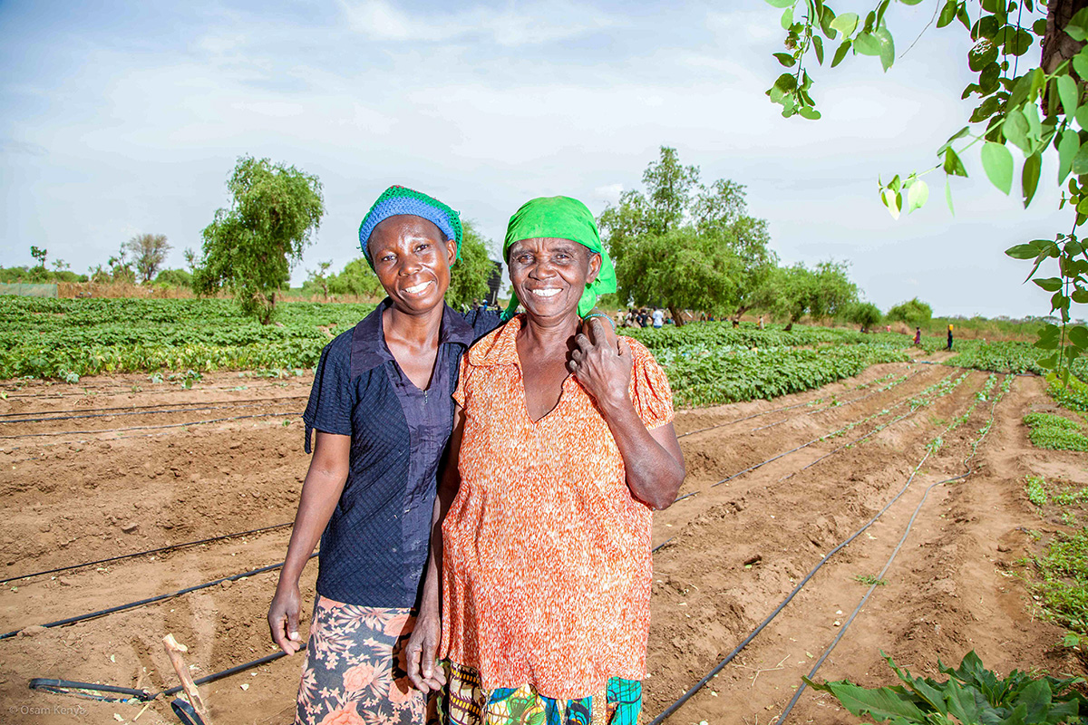 Mlasi Salima (right) and her daughter Sofia, at a 3-acre farm in Kenya's Kakuma refugee camp. By providing access to seeds, tools and other equipment, this UNHCR-supported project helps South Sudanese refugees become more self-reliant.