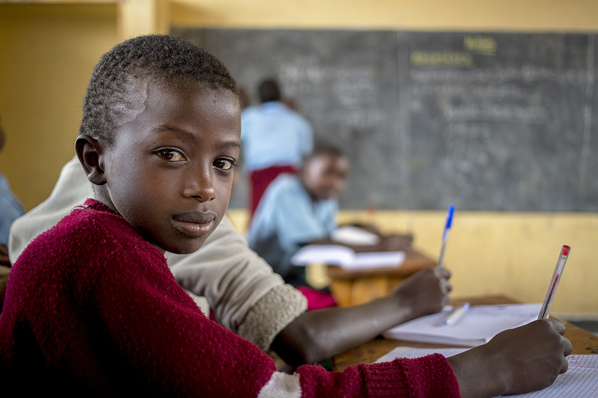 12-year-old Burundian refugee Muganzifuri studies math in Mahama refugee camp.