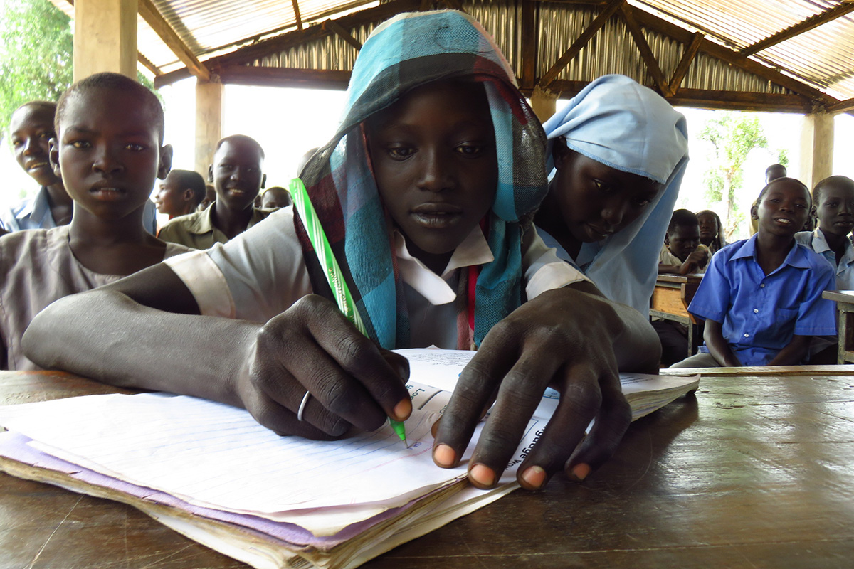 """I'm so happy that I can read. Now I can finally dream of my future,"" says 12-year-old South Sudanese refugee Khajida."