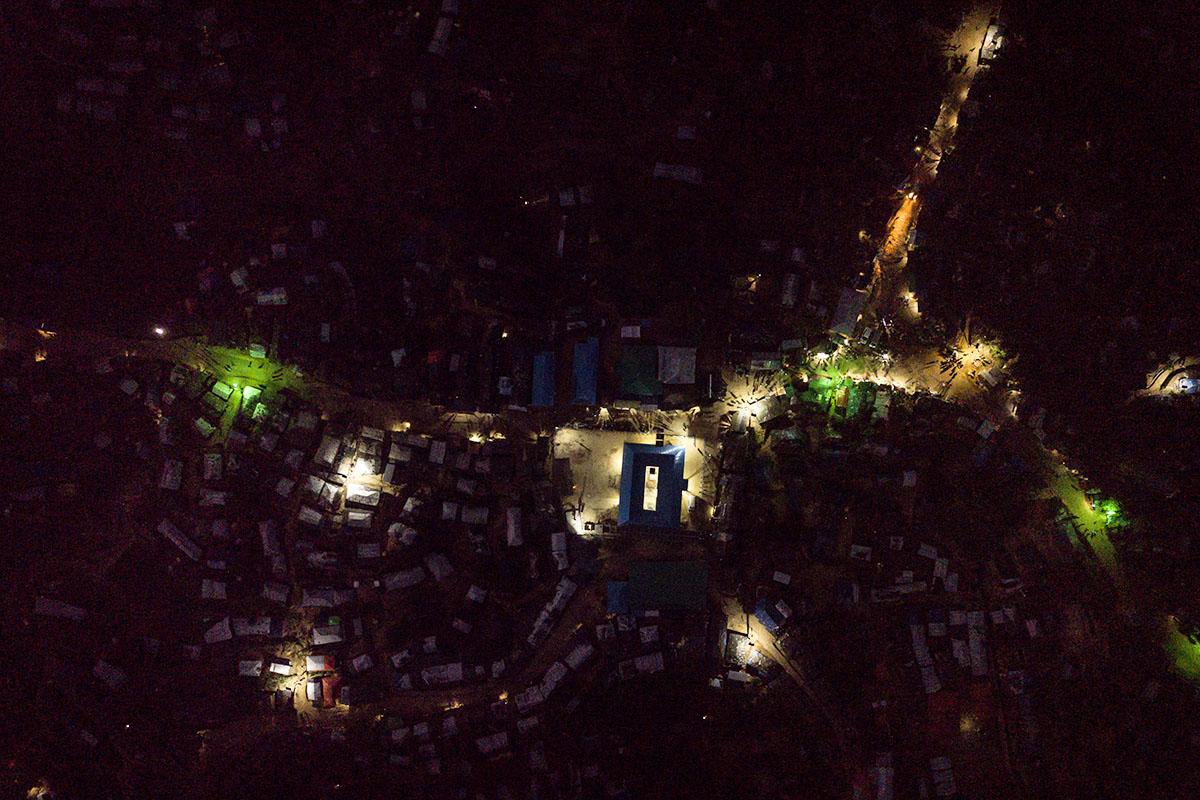 An aerial shot of Kutupalong refugee camp in Bangladesh lit up by UNHCR-supplied solar lanterns.