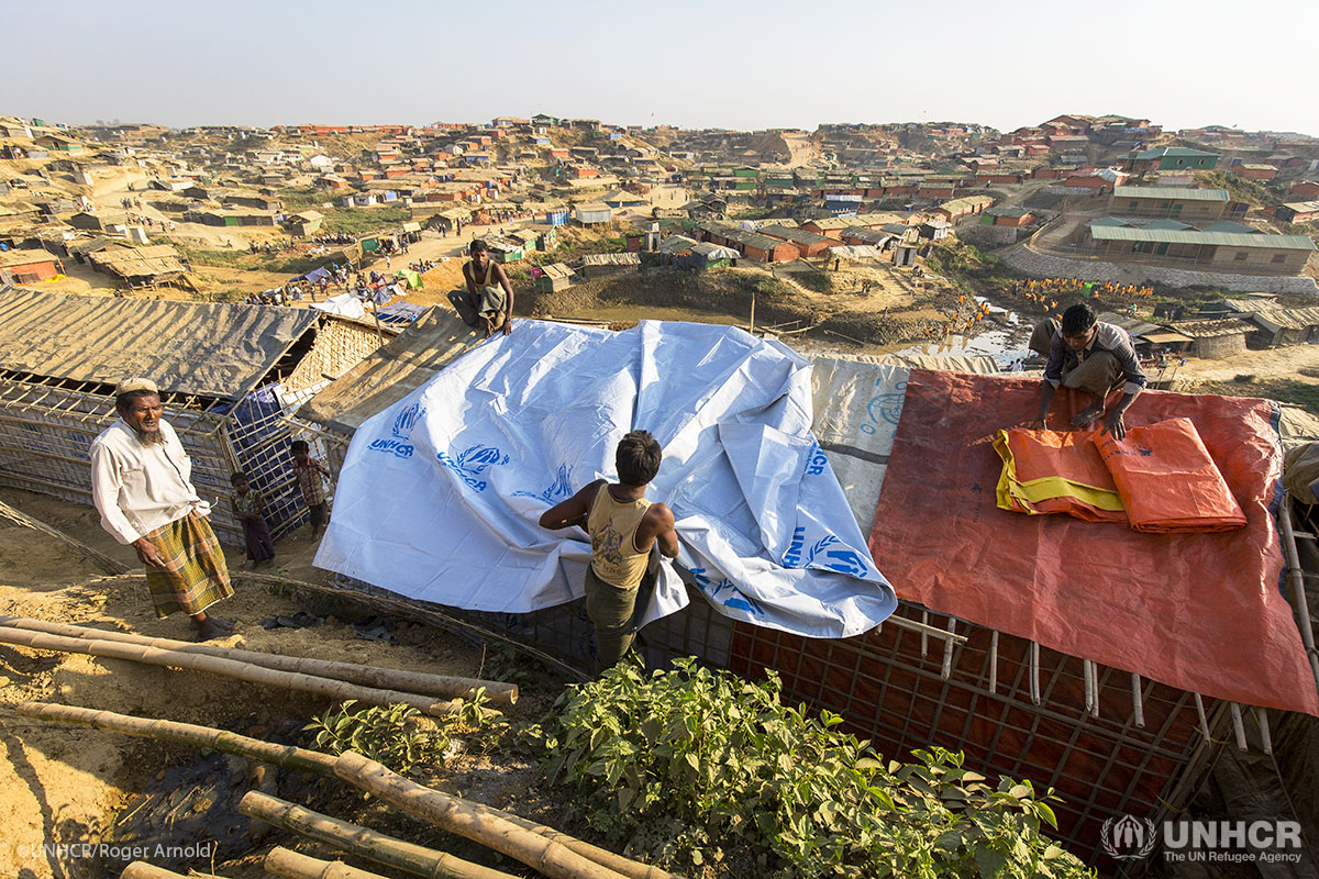 Rohingya refugees strengthen their shelters with bamboo, sheeting and other materials at Kutupalong refugee camp in Bangladesh.