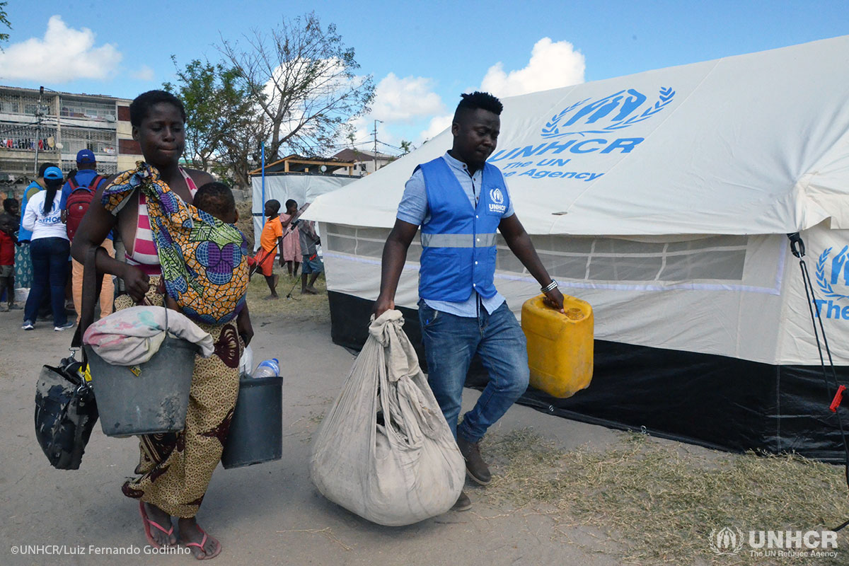 Kitungano Kinga, a refugee from the Democratic Republic of the Congo, helps displaced people in Beira, Mozambique to relocate after Cyclone Idai.