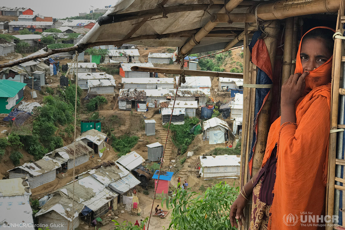 bangladeshi woman looking out from her shelter at the chakmarkul refugee settlement