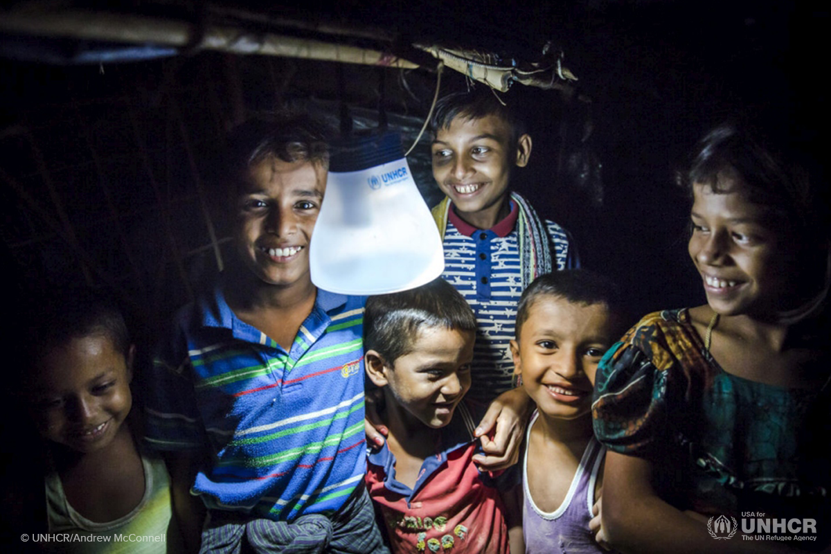 rohingya refugee family light up their shelter with a solar lantern as part of a climate action plan