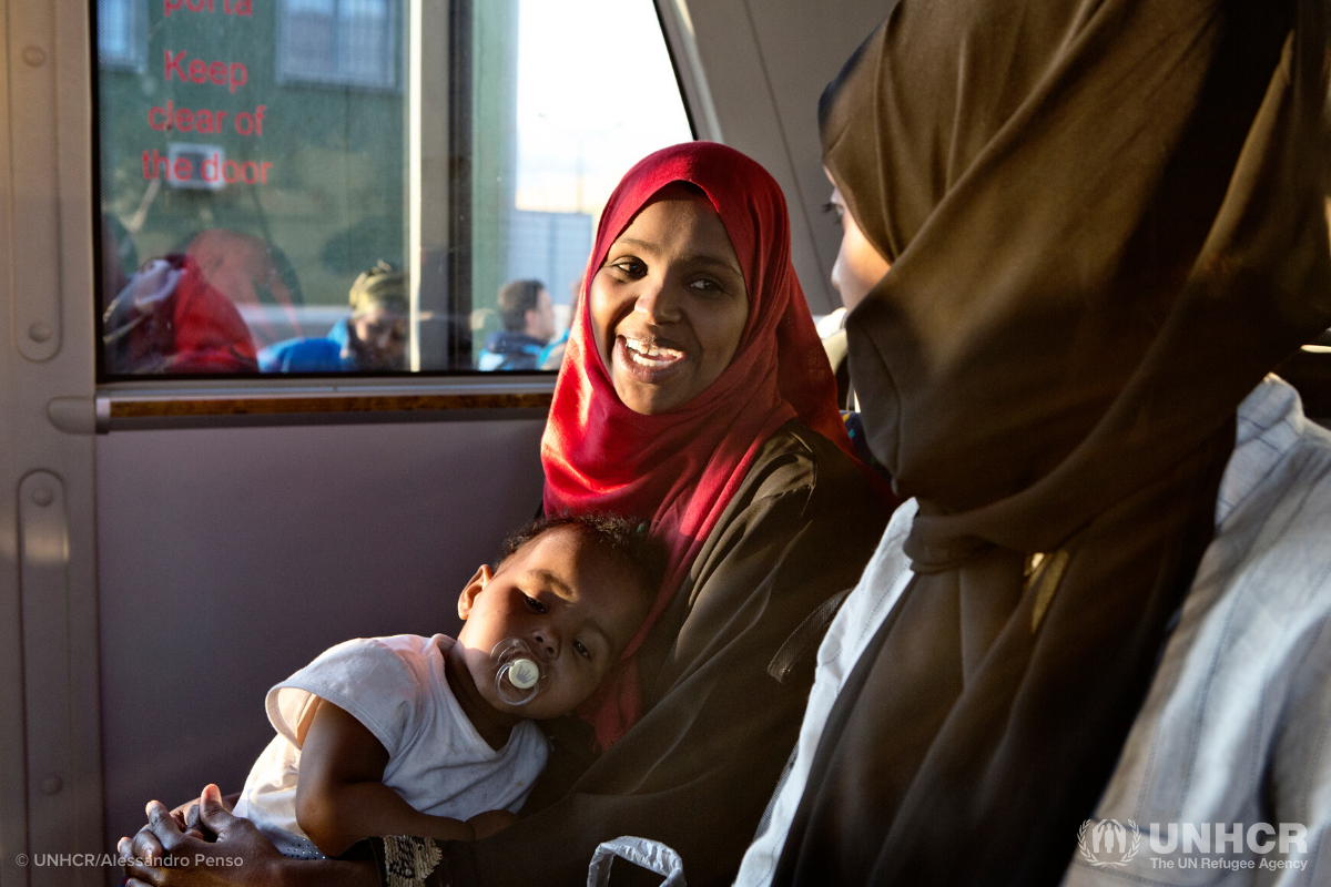 Somali mother sitting on bus with her baby