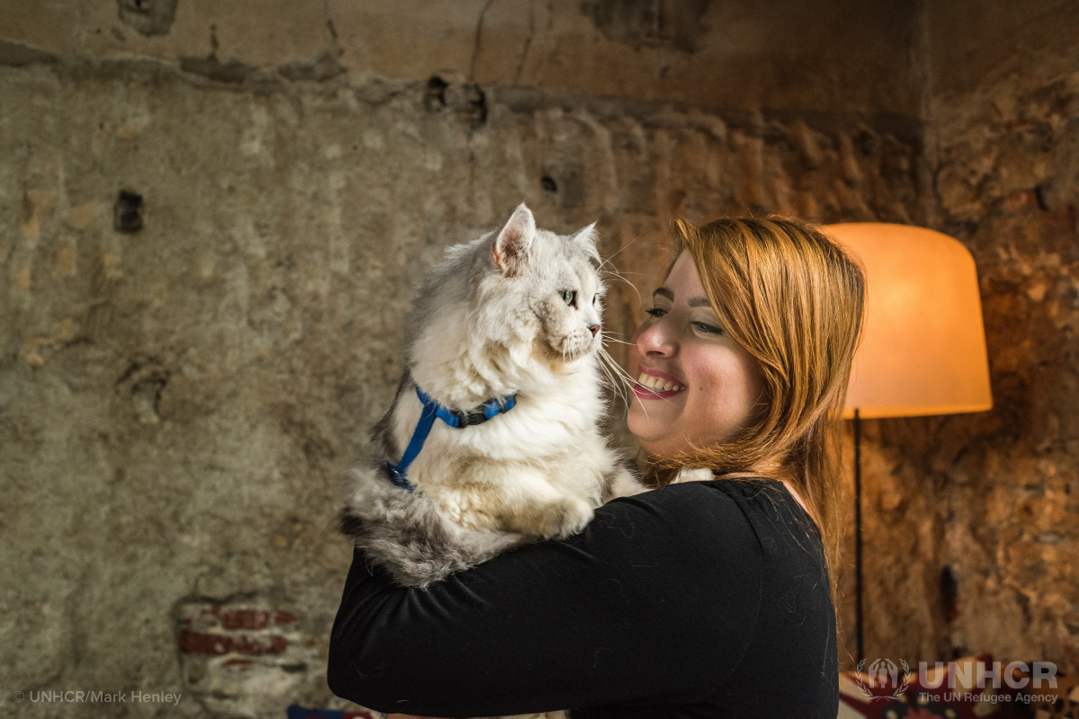 Syrian refugee Darin and her cat Caesar